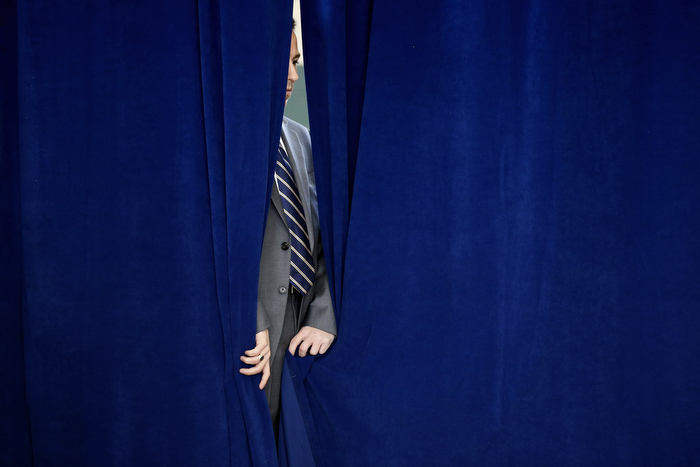 Waiting To Open Curtain - Matt Palmisano, a member of the NJ Gov. Christie's advance team, waits to open curtains prior to Christie being introduced at Christie's 128th Town Hall Meeting held at the Moorestown Recreation Center.  Wednesday February 25, 2015. Moorestown, NJ, USA