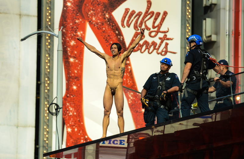 First Place Marcos Santos / NY Daily News - NAKED TIMES SQUARE MAN GQ coverboy Krit McClean bared his rump, screamed for Donald Trump and took a 15-foot plunge to the ground while NYPD tried to intervene. New York, Manhattan, Times Square. Thursday, June 30, 2016.