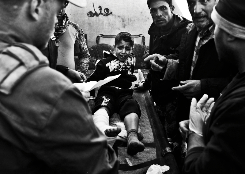 Ahmed Muhammad Fars, 9, of Mosul, is treated at the Gogjali field clinic in Iraq after injuries sustained from a mortar attack in Mosul, Iraq on November 24, 2016. Nearly two years since the Islamic State took the city of Mosul in northern Iraq, the Iraqi Army launched an offensive to wrest the city back from the insurgency in October of 2016.