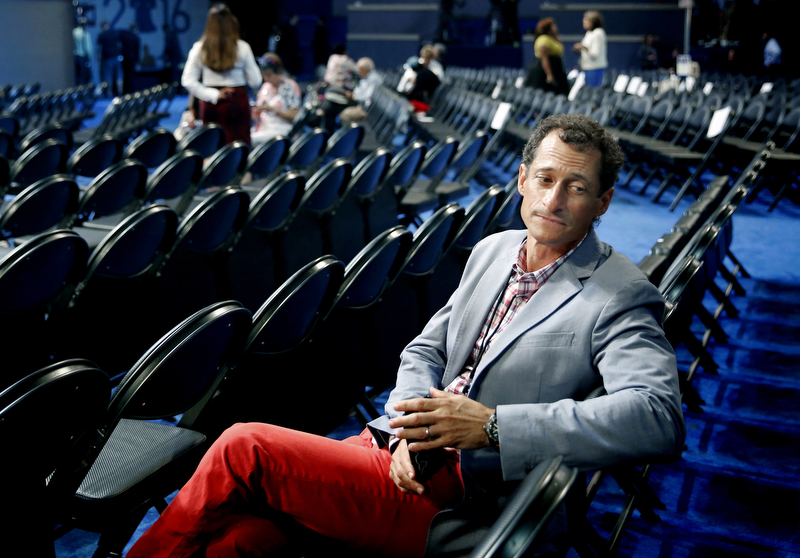 Disgraced and former NY Congressman Anthony Weiner sits alone on the convention floor prior to the evenings session. His wife Huma Abedin has been a long time aide to Hillary Clinton. A month latter it is reported that he took a raunchy selfie with his 4-year-old son in the background. Abedin then announced that they were separating. Then the FBI announces just prior to the election that they were search Weiner's laptop and found Hilary Clinton emails. The 2016 Democratic National Convention in Philadelphia.  Tuesday July 26, 2016. Philadelphia, PA, USA  