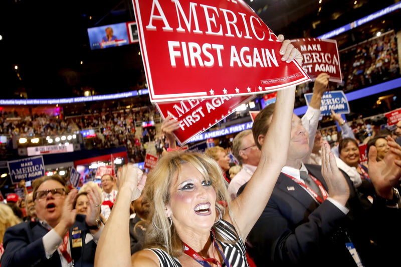 "California delegate Kim Davis shouts ""Lock Her Up,"" in reference to Hillary Clinton, during the evening session of the 2016 Republican National Convention in Cleveland, Ohio, July 20, 2016."