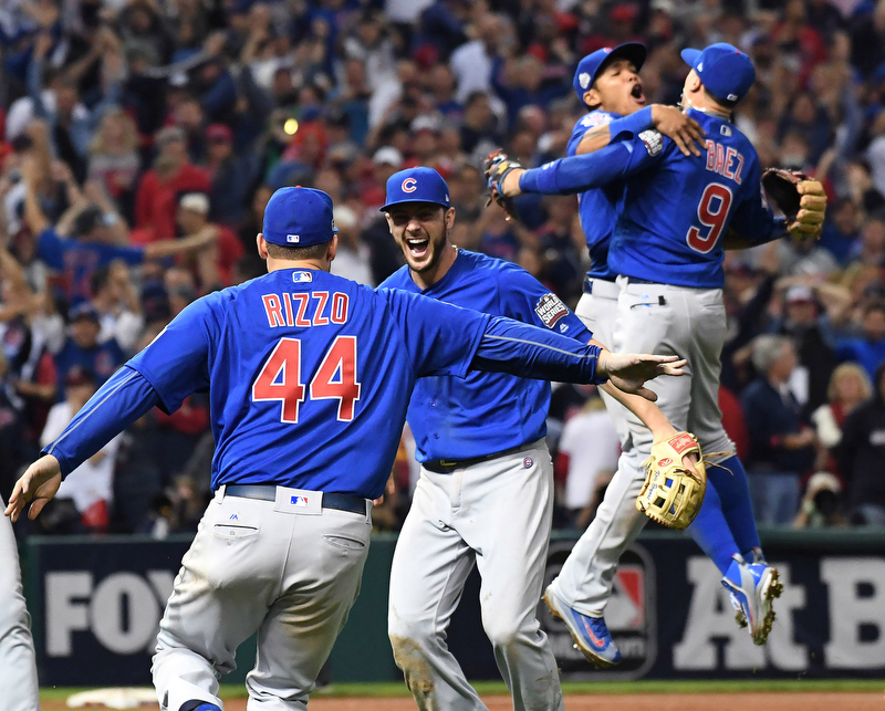 Chicago Cubs Kris Bryant celebrates with Anthony Rizzo as teammates Addison Russell and Javier Baez leap in the air after the final out over the Cleveland Indians in the 10th inning of World Series game seven in Cleveland, Ohio, in the early morning of November 3, 2016. Chicago won 8-7 to celebrate their first World Series championship in 108 years.
