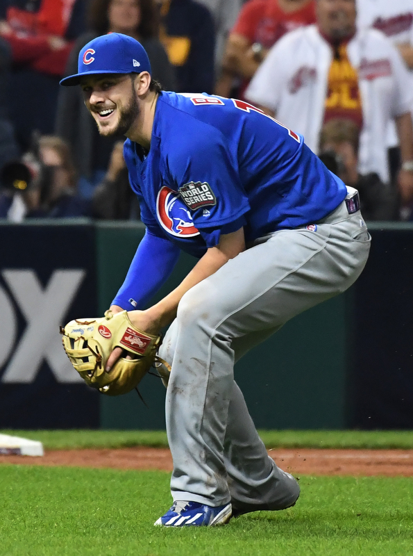 Chicago Cubs third basemen Kris Bryant smiles as he grabs a weak grounder off the bat of Cleveland Indians Michael Martinez in the 10th inning of game 7 of the World Series in Cleveland, Ohio in the early morning of November 3, 2016. Bryant, the World Series MVP, threw to first for the final out as Chicago won 8-7 to celebrate their first World Series championship in 108 years.
