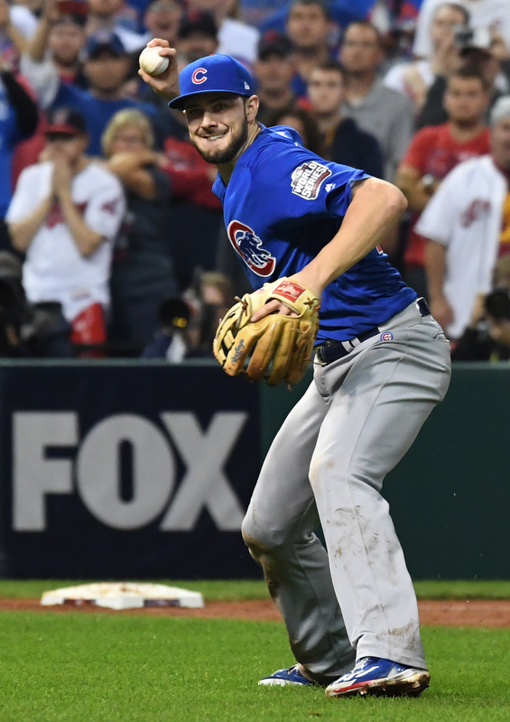 Chicago Cubs third basemen Kris Bryant smiles as picks up a  weak grounder off the bat of Cleveland Indians Michael Martinez and throws to first for the final out in the 10th inning of game 7 of the World Series in Cleveland, Ohio in the early morning of November 3, 2016. Bryant was the World Series MVP and Chicago won 8-7 to celebrate their first World Series championship in 108 years.