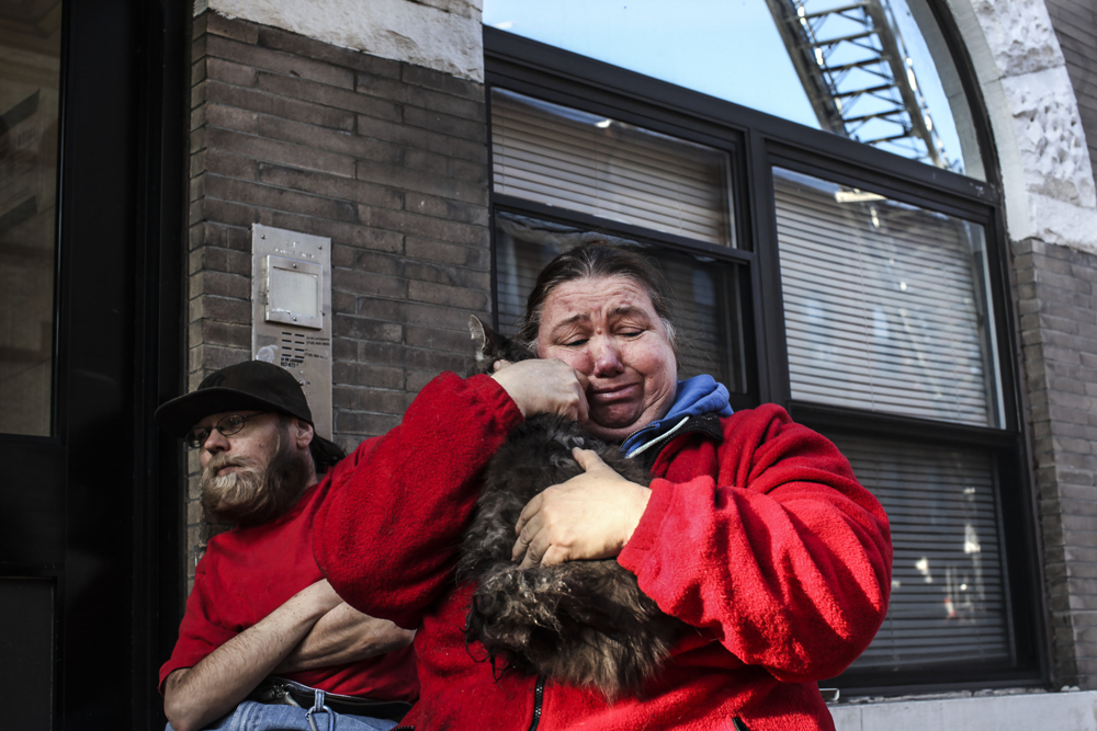 Nora Castello, center, a resident for 35 years at 237 Stanhope Street, cries as she hugs her 5-year-old cat Roscoe after a 2-alarm fire ripped through her apartment a week before Thanksgiving in Brooklyn on Friday, November 17, 2017.