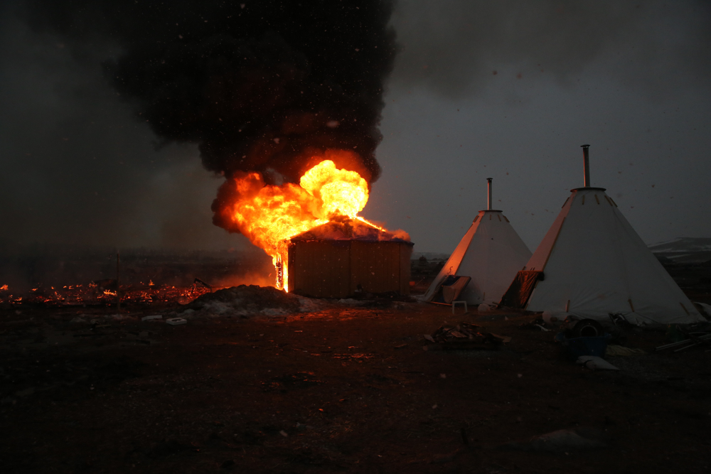 February 22, 2017: Cannonball, ND - A structure is set on fire by campers in anticipation of a raid by law enforcement at the Oceti Sakowin camp. Led by the Standing Rock Sioux tribe to protest the Dakota Access Pipeline, the camp was dismantled by authorities the next day.