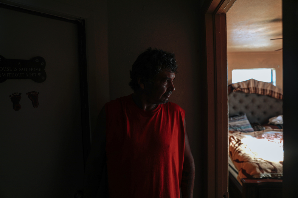September 12, 2017: Immokalee, FL - Andres Delarosa surveys damage inside his house, which was flooded by heavy winds and rain from hurricane Irma. The town of Immokalee, home to migrant farm workers and immigrants from Haiti and Latin America, was one of the hardest hit by the category 5 storm.