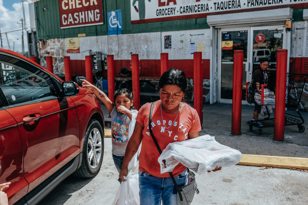 September 25, 2017: Immokalee, FL - Sandra Guzman buys groceries to bring to her temporary trailer home. The town of Immokalee, home to migrant farm workers and immigrants from Haiti and Latin America, was one of the hardest hit by the category 5 storm.
