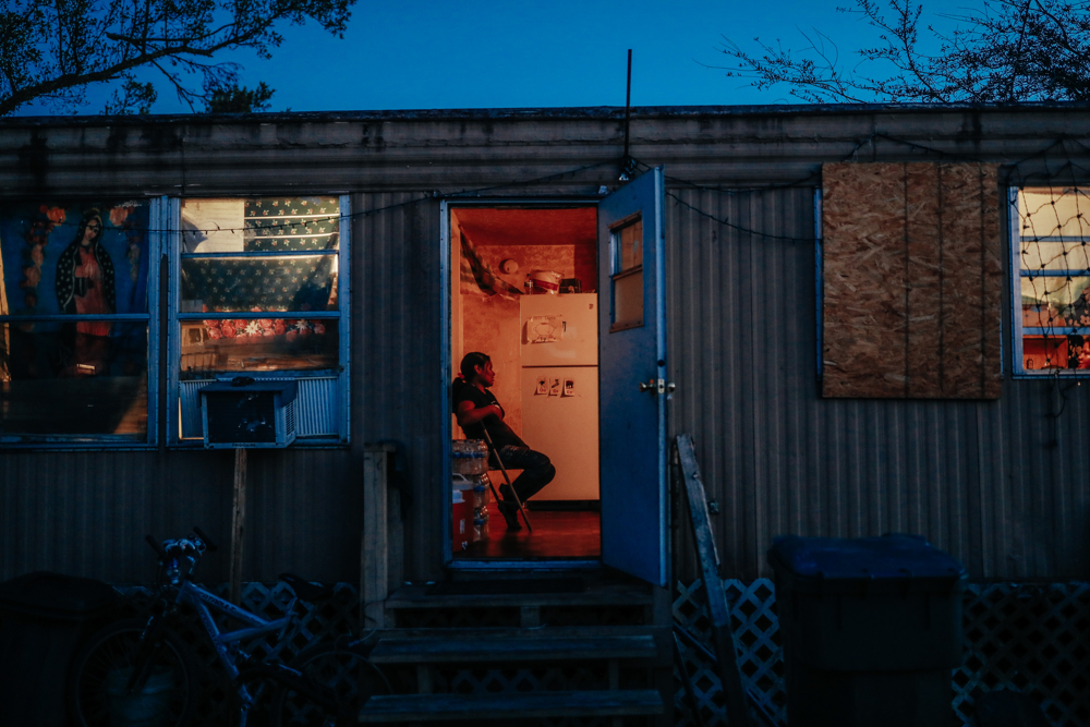 September 12, 2017: Immokalee, FL - A woman sits in her home after heavy flooding. The town of Immokalee, home to migrant farm workers and immigrants from Haiti and Latin America, was one of the hardest hit by the category 5 storm.