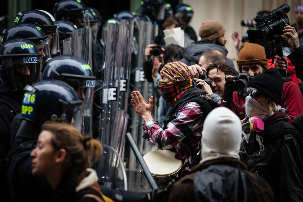 A masked protestor confronts police lines during the mayhem on Inauguration Day near Franklin Square on January 20, 2017 in Washington DC, USA.