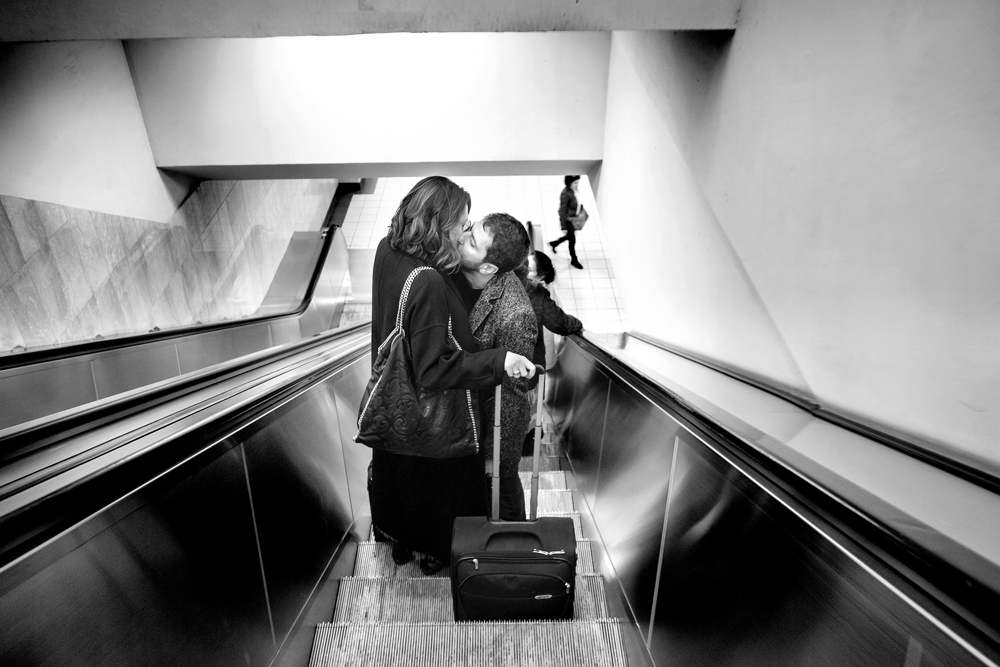 Lovers Escalator - A pair of lovers kiss while riding an escalator in the Monastiraki Subway station in Athens.  Sunday November 12, 2017. Athens, Greece