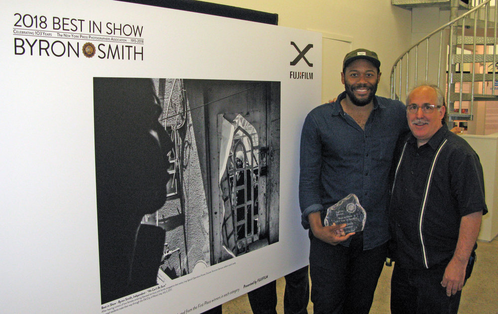 NYPPA President Bruce Cotler presents Byron Smith with The Fujifilm Best in Show Award at the 198 Gallery in Brooklyn on May 17, 2018