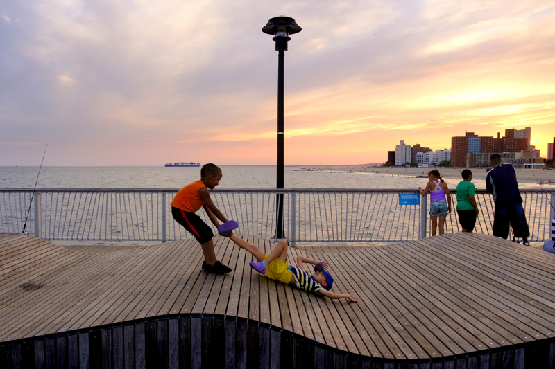 Boys Fun - A pair of boys play on the pier during sunset.    Thursday August 10, 2017. Brooklyn, NY, USA