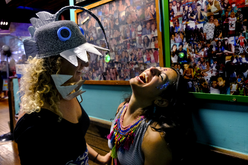 While inside Ruby's Bar & Grill a woman wearing an Angler Fish hat jokes with another after the 2017 Coney Island Mermaid Parade.  Saturday June 17, 2017. Brooklyn, NY, USA