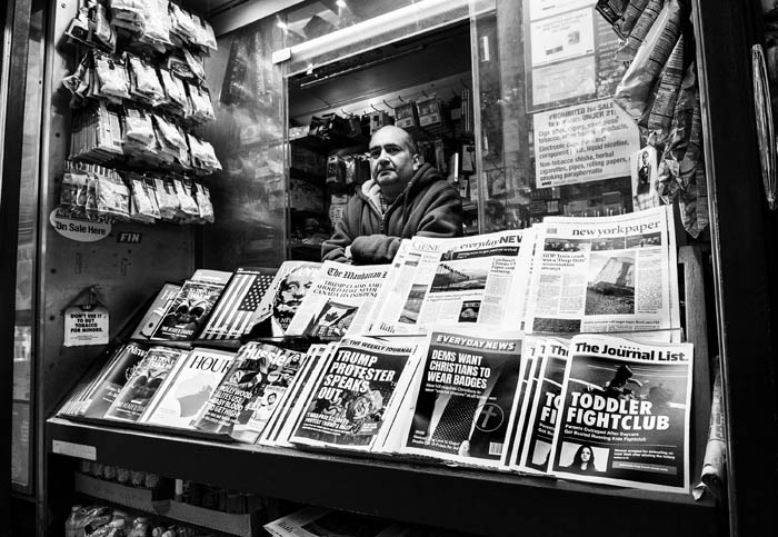 """The """"first-of-its-kind"""" """"Misinformation Newsstand"""" on Sixth Avenue and 42nd Street, one block from Times Square, in New York City, New York on October 30, 2018. The Columbia Journalism Review (CJR) erected it  """"to educate news consumers about the dangers of disinformation in the lead-up to midterms"""". The newsstand contains totally fake periodicals with fake headlines and articles. Quoted sections of this caption were taken from the CJR press release about the newsstand."""
