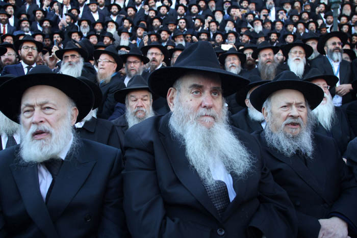 "Thousands of bearded Hasidic rabbis, clad in traditional Hasidic grab, line up outside of their worldwide headquarters at 770 Eastern Parkway in Brooklyn N.Y. for their ""class picture.""  This year, however, with the tragedy on everyone's minds and the wound still raw, the delegation of rabbis from Pittsburgh will lead thousands of their colleagues in a prayer ceremony and in solemn song to remember those massacred and pray for their families and those injured."