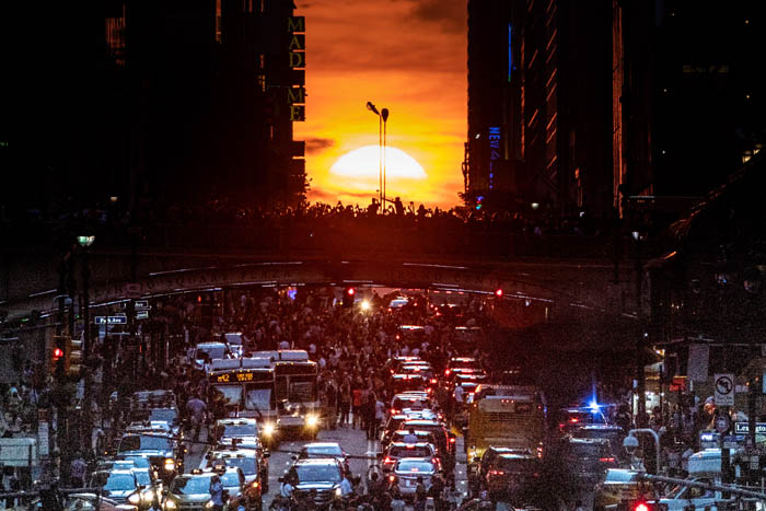 Manhattanhenge sun set. Manhattanhenge is where the rising or setting sun aligns with the street grid in Manhattan, New York City. Here it is as seen from 42nd Street in Manhattan in New York City on July 12, 2018