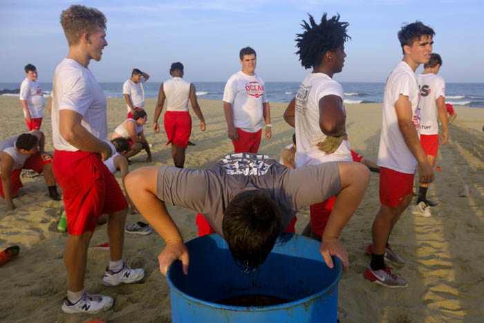 Ocean Township football team practices on beach as part of the preseason conditioning. Wednesday August 1, 2018. Asbury Park, NJ, USA
