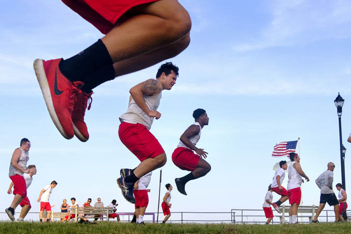 Ocean Township football team practices at the beach as part of the preseason conditioning. Wednesday August 1, 2018. Asbury Park, NJ, USA