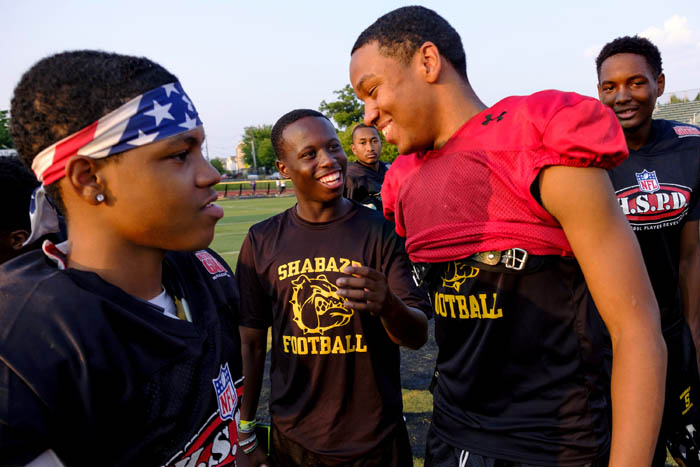 Quarterback Anthony Travis, right, jokes with teammates after practice. The preseason football camp of Malcolm X Shabazz High School. Thursday August 16, 2018. Newark, NJ, USA