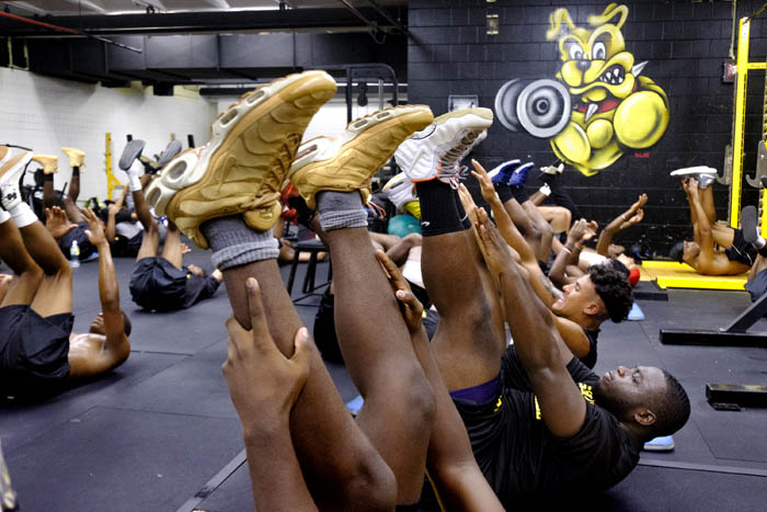 Micheal Bright and Daniel Angemang and other members of the team work out in the schools weight room. The preseason football camp of Malcolm X Shabazz High School. Thursday August 16, 2018. Newark, NJ, USA