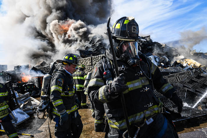 Volunteer firefighters from the West Babylon Fire Department extinguish a fire at Gershow Recycling in Lindenhurst, Thursday, Sept. 27, 2018.