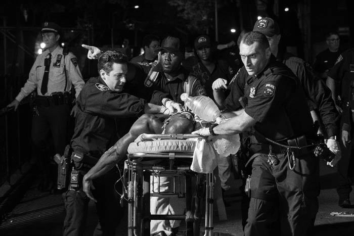 Police and medics remove a shooting victim in Brooklyn on October 5, 2018.