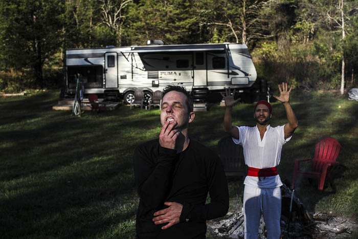 "Recovering opioid addict Neal Catlett, of Lexington, Kentucky, left, involuntarily reacts after smoking the venom bufo alvarius, which is secreted from a rare toad found in the Mexican desert, during a ""healing ceremony""  under the watch of ""shaman/sitter"" named Madhu in Lexington on Thursday, October 19, 2017. Catlett, who wants to start a church using the substance, as well as a growing contingent of users, believe the venom can help with reducing and ultimately overcoming many forms of addiction, depression, PTSD and anxiety."