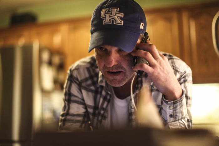 "Recovering opioid addict Neal Catlett, of Lexington, Kentucky, fields calls from other addicts who may need to take part of a ""healing ceremony""  in Lexington on December 11, 2017. Catlett, who wants to start a church using the substance, as well as a growing contingent of users, believe the venom can help with reducing and ultimately overcoming many forms of addiction, depression, PTSD and anxiety."