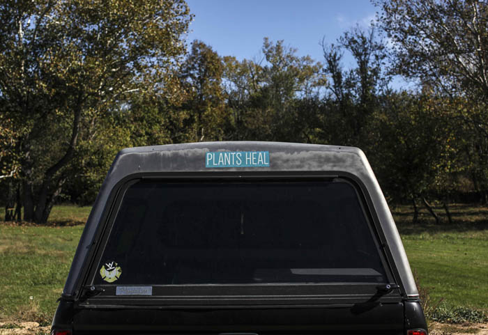 A friend of Neal Catlett parks his truck on a plot of land where bufo ceremonies will be held later on that day for addicts and those interested in the drugs said healing properties on October 18, 2017. Catlett, who wants to start a church using the substance, as well as a growing contingent of users, believe the venom can help with reducing and ultimately overcoming many forms of addiction, depression, PTSD and anxiety.