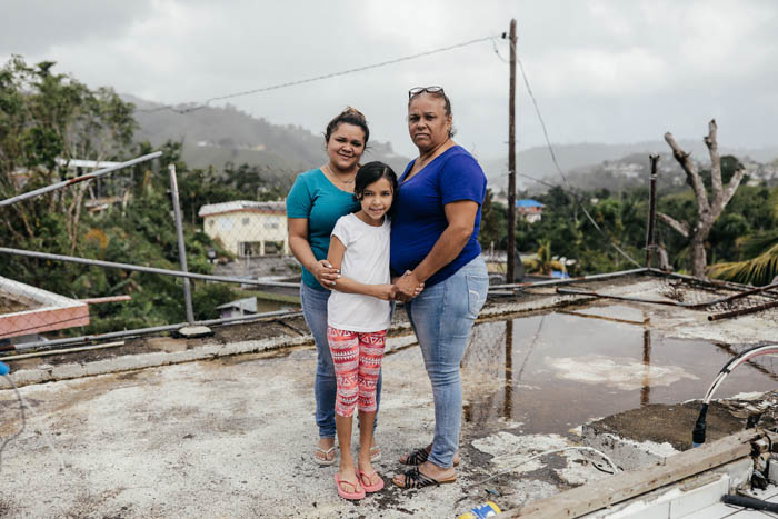 February 12, 2018: Naranjito, Puerto Rico -  Mayla Negron, 50, a cardiology tech, with her daughters Karlyris Soto, 23, and Mia Sophia Soto, 9. Negron lost half of the house she shares with her parents and her kids and suffers from severe anxiety. Nearly 5 months after Hurricane Maria reached the island around 1/3 of Puerto Rico is still without power.  After a catastrophic hurricane, rates of mental illness continue to rise.
