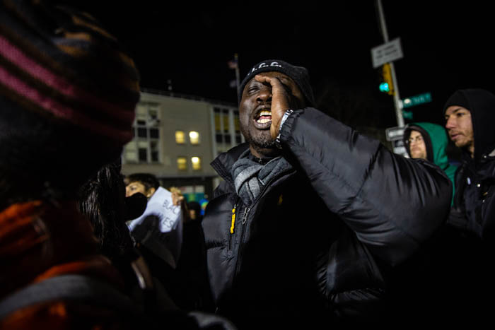 A man shouts towards nearby NYPD officers as demonstrators gather on Empire Boulevard to protest outside the 71st Precinct in Crown Heights, Brooklyn on April 5, 2018 in New York City, USA.  