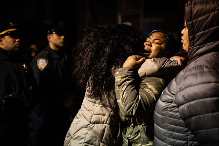 A woman comforts her friends she cries during a protest held on at the corner of Utica Avenue and Montgomery Street in Crown Heights on April 5, 2018 in New York City, USA.  