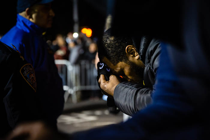 A man bows his head in dispair as demonstrators gather on Empire Boulevard to protest outside the 71st Precinct in Crown Heights, Brooklyn on April 5, 2018 in New York City, USA.  