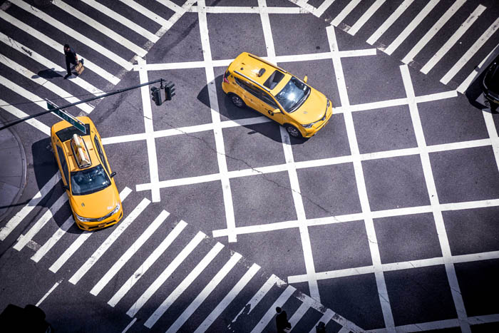 Colorful taxis in a checkerboard intersection