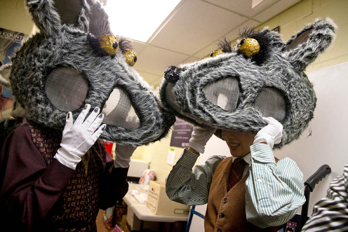 While backstage Hallie Rumsey-Lasersohn, left, and Moeno Oba don their rat heads for the upcoming Battle scene.  Friday November, 30, 2018. Rahway, N.J., USA