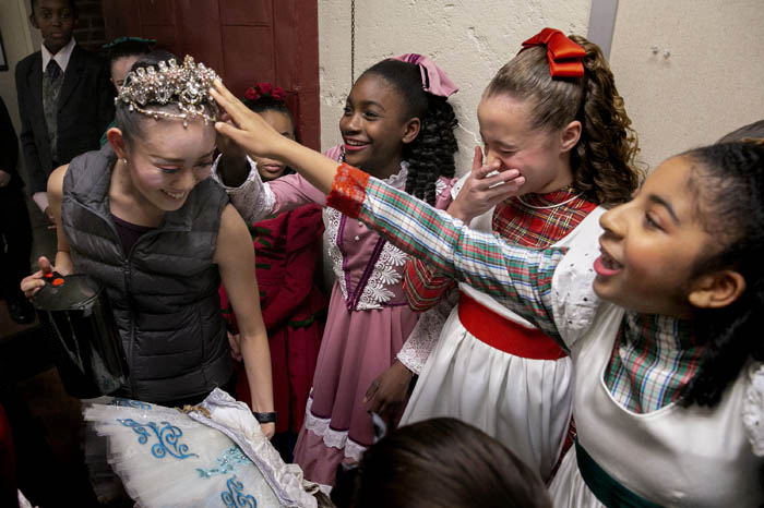 While on her way to get some water backstage prior to the show, Nanako Yamamoto who portrays the Snow Queen, has younger Party scene performers check out her crown.  Friday November, 30, 2018. Rahway, N.J., USA
