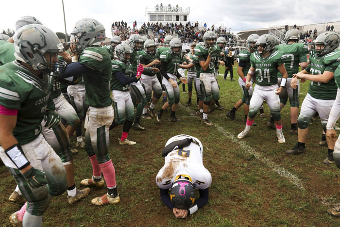 Marlboro quarterback Alex Schutzer  is surrounded by Colts Neck High School football players after his final pass play was incomplete and lost the game 20-14 over rival Colts Neck . 10/13/2018
