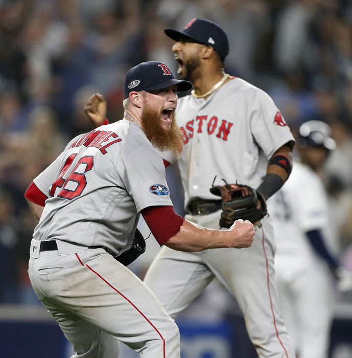 Craig Kimbrel #46 and Eduardo Nunez #36 of the Boston Red Sox celebrate after defeating the New York Yankees in Game 4 of the ALDS at Yankee Stadium on Tuesday, Oct. 9, 2018 in the Bronx borough of New York City.