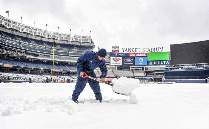 Members of the grounds crew at Yankee Stadium work to clear snow off the field after today's New York Yankees  home opener was postponed due to snow.  April 2, 2018.