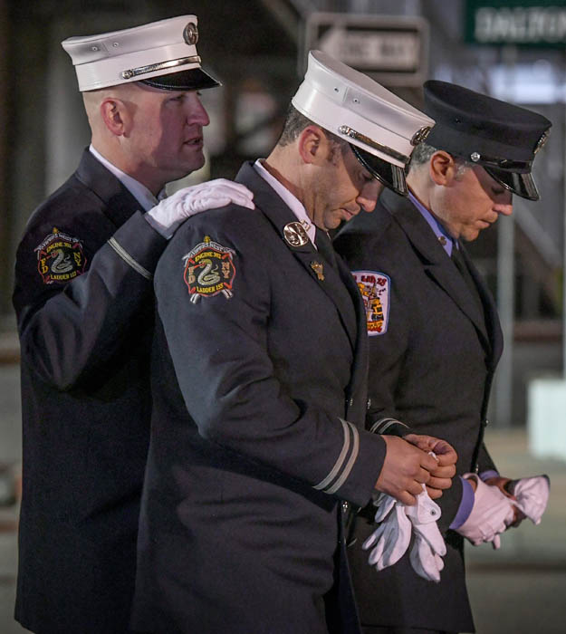 FDNY Captain Daniel Kudlak, center, who worked with fallen FDNY Firefighter Michael Davidson is comforted by comrades as gather to pay their respects to Davidson during his wake at the Dalton Funeral Home in Floral Park. March 26, 2018.