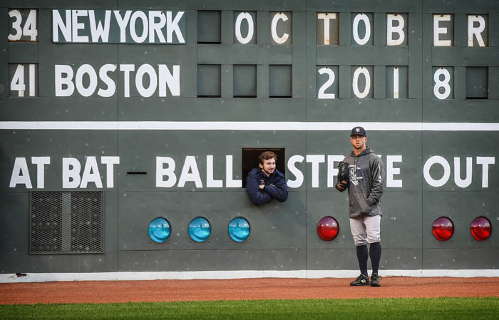 Prior to the start of game one of the American League Division Series,  New York Yankees Brett Gardner chats with a scoreboard operator through a window in the scoreboard of Fenway Park's famed Green Monster.   October 5, 2018.
