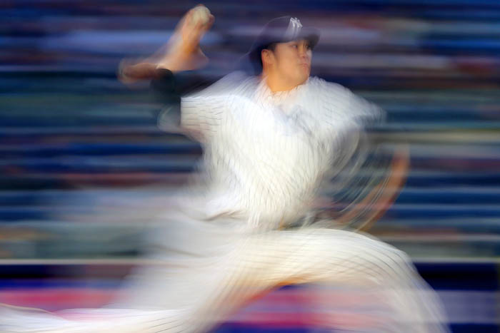 Apr 17, 2018; Bronx, NY, USA; New York Yankees starting pitcher Masahiro Tanaka (19) pitches against the Miami Marlins during the second inning at Yankee Stadium.
