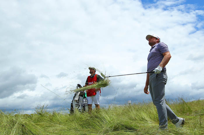 Top golfers from around the world compete in the 2018 US Open from Thursday, June 14 through Sunday, June 17 at Shinnecock Hills Golf Club in Southampton, NY. Tyrrell Hatton hits out of the fescue on the twelfth fairway during round 2.
