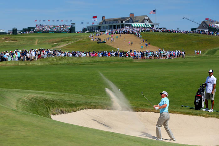Top golfers from around the world compete in the 2018 US Open from Thursday, June 14 through Sunday, June 17 at Shinnecock Hills Golf Club in Southampton, NY. Charley Hoffman hits out of a bunker off the first green during round 3.
