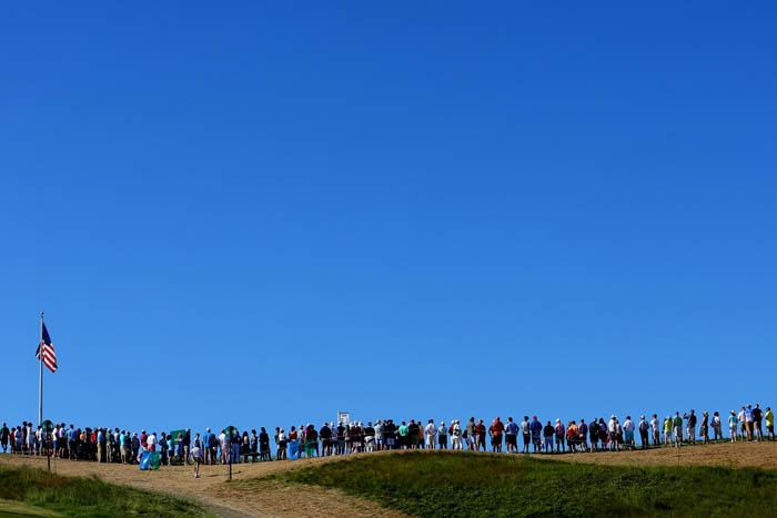 Top golfers from around the world compete in the 2018 US Open from Thursday, June 14 through Sunday, June 17 at Shinnecock Hills Golf Club in Southampton, NY. Fans gather around the first tee box to watch the first group of the day tee off for the final round.
