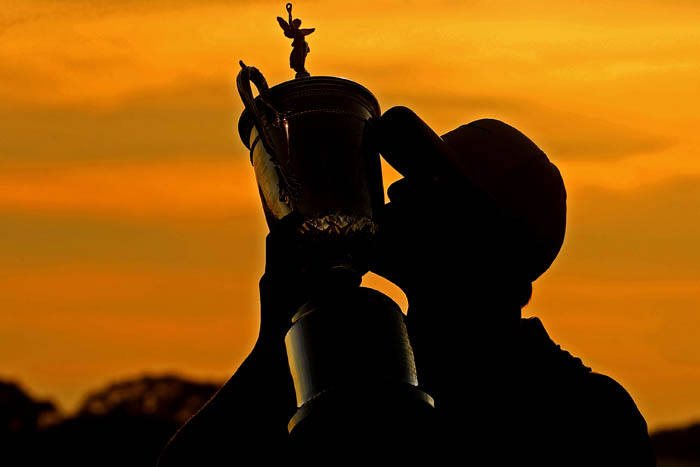 Top golfers from around the world compete in the 2018 US Open from Thursday, June 14 through Sunday, June 17 at Shinnecock Hills Golf Club in Southampton, NY. Brooks Koepka kisses the trophy after winning the tournament.