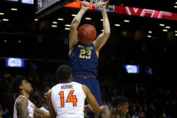 Fifteen teams competed in the 2018 Atlantic Coast Conference Tournament from Tuesday, March 6 through Saturday, March 10 at the Barclays Center in Brooklyn, NY. Notre Dame Fighting Irish forward Martinas Geben (23) dunks against Virginia Tech Hokies guards Justin Bibbs (10) and Ahmed Hill (13) and forward P.J. Horne (14) during the second half of a second round game.