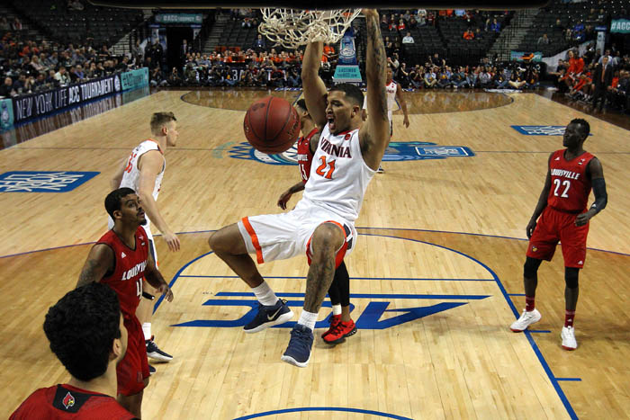 Fifteen teams competed in the 2018 Atlantic Coast Conference Tournament from Tuesday, March 6 through Saturday, March 10 at the Barclays Center in Brooklyn, NY. Virginia Cavaliers forward Isaiah Wilkins (21) dunks against Louisville Cardinals forward Ray Spalding (13) and guard Quentin Snider (4) during the first half of a quarterfinal game.