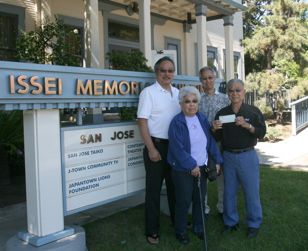 The Matsumotos dropped by the IMB to hand over their donation check. Front row: Lucy Matsumoto and Ray Matsumoto. Back row: Leon Kimura and Tom Oshidari.